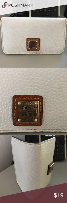 Authentic Dooney & Bourke phone case/card holder. White leather Dooney and Bourke phone case and card holder. Made for iPhone 5 or similar size phone. I've used it a a cash wallet by putting cash where the phone goes. Practically brand new. Used only a handful of times. Still have certificate of authenticity as well. Dooney & Bourke Accessories Phone Cases
