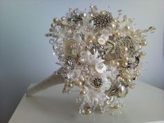 Vintage jewelry, bead, white button bouquet. (What a wonderful way to use family heirloom pieces for a memorable occasion!)