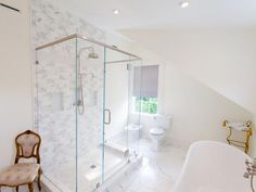exposed piping shower fixture with hand held frameless glass shower surround with header
