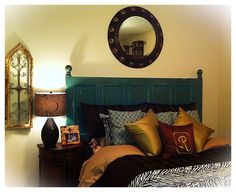 I love this! An antique door painted and turned into an awesome headboard!