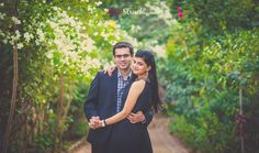 Shrey dressed in an all black gown with gold and oxidized embellishment for their pre wedding photo shoot