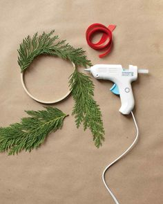 Turn a few snippings from your backyard evergreens or Christmas tree into a cheery display.