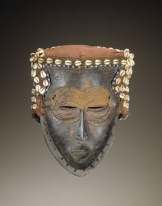 1994: @nmafa acquires this face mask (Lele artist, DRC, early‑mid 20th c.).  By the 90s, @nmafa was renowned for its collection & this mask graced the cover of its 1st published catalogue. Lele visual arts are rich in boxes, pipes & cups but masks are rare. This mask is one of the few that exists outside Africa. Lele masks are thought to have appeared in dances accompanying the burial rites of chiefs & in annual creation ceremonies. How would you describe it in 1 word? #africanartat50
