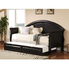 """""""Make this daybed with an old king size headboard and footboard. Use a siderail across the front.  Make a platform on wheels and a wooden shutter for the side to hold the extra mattress."""" by bonnie"""