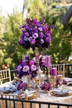 purple tall centerpiece for wedding  / http://www.himisspuff.com/purple-wedding-ideas/11/