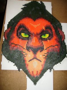 Classing this as a failed attempt since this bastard just REFUSED to fuse together. Kinda fitting for a Disney bad guy, I guess. Needless to say, I'm a bit sad that he wouldn't fuse.but in a sens. Hama Beads Disney, Diy Perler Beads, Perler Bead Art, Pearler Bead Patterns, Perler Patterns, Hama Beads Design, Peler Beads, Beads Pictures, Le Roi Lion