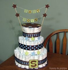 Diaper cake for baby shower--boy example.  Our older girls made diaper cakes as a club project.