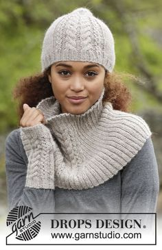 Winter Wired / DROPS 173-21 - Knitted DROPS hat, neck warmer and wrist warmers with cables in Puna.