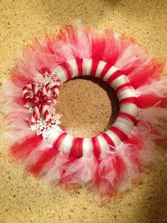 Tulle wreath I made for our candy cane theme decorations Tulle Projects, Tulle Crafts, Wreath Crafts, Diy Wreath, Wreath Ideas, Christmas Mesh Wreaths, Christmas Door Decorations, Christmas Ornaments, Holiday Themes
