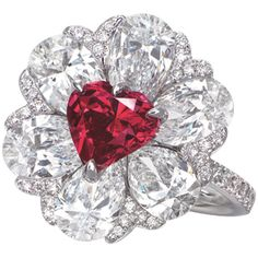 "Christie\\'s Hong Kong Magnificent Jewels – Most Expensive Red Diamond RecordChristie\\'s set a new world record for the most expensive red diamond to be sold at auction during its autumn Hong Kong Magnificient Jewels sale. ""Gem on Fire"", a heart shaped fancy red diamond and diamond ring created by Moussaieff, ..."
