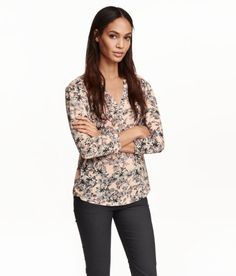 Check this out! Wide-cut top in soft, airy jersey. V-neck and buttons at front, 3/4-length puff sleeves, seam at yoke, and rounded hem with short slits at sides. - Visit hm.com to see more.
