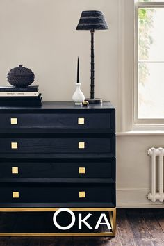 Sleek black furniture and sharp silhouettes bring a contemporary style, with brass accents adding a dash of embellishment. Discover the look.