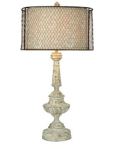 Discarded chicken wire, which is softened by a natural linen shade underlay, becomes new again on this rustic Perm lamp from Aidan Gray. www.aidangrayhome.com