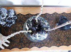 Spooky black velvet Halloween cake with marshmallow web and black candy apples