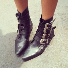 Buckled heaven - love these edgy ankle boots.