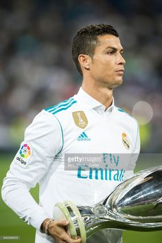 Cristiano Ronaldo #7 of Real Madrid holds the UEFA Super Cup trophy prior to the La Liga match between Real Madrid and Valencia C.F. at the Santiago Bernabéu Stadium on August 27, 2017 in Madrid, Spain. The match ended in a tie of 2 to 2.