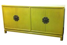 described by Zainido Vintage Stunning credenza in rich chartreuse with Asian-inspired structure and brass details. Interior left side has a pull out shelf, interior right side is open for large storage. Attributed to James Mont. Asian-Inspired Chartreuse Credenza on OneKingsLane.com