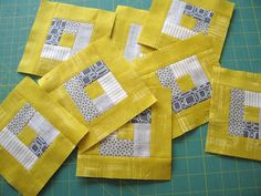 Try this with a Mug Rug.  modern log cabin quilt block. Mostly I luv the color combos...