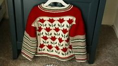 Tulip Sweater in size 6.One of a kind, floral and striped pullover in red, green, cream and tan.Ultra soft yarn, perfect for back to school.
