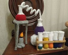 Having seen someone else's crocheted chemistry set online, I decided to make my own: The patterns for various bits and bobs can be found in my other posts (which will be up shortly if they ar… Diy Crochet And Knitting, Cute Crochet, Crochet Crafts, Crochet Dolls, Yarn Crafts, Crochet Baby, Crochet Projects, Amigurumi Patterns, Crochet Patterns