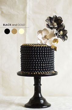 Black + Gold http://www.theperfectpalette.com/2013/11/10-wedding-color-palettes-you-need-to.html