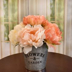 A beautifully hand crafted designer bouquet created peach and cream peonies. Placed in a  metal garden planter. Set this design just about anywhere in your home or office.  Great  idea for gifts.  Perfect size for RVs, , side tables and baths. 11'' H x 10'' W x 10'' D