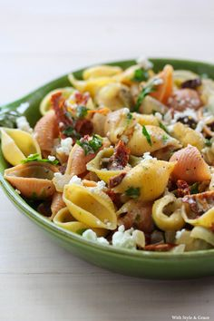 Pasta with sun-dried tomatoes, olives, and goat cheese.