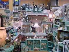 Shabby chic booth  Way cool display  Stacked Painted Tables  cubbies