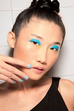 Go ahead, match your eyeshadow to your turquoise nail polish.