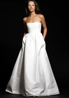 Clean, crisp, simple wedding dress...  BUT, a wedding dress with Pockets!!