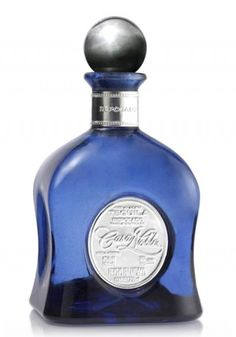 This exquisite tequila is matured in French white Oak barrels for three hundred sixty four days. Smooth, sensuous and full bodied, this tequila rivals the best spirits in the world. Contained in a beautiful hand blown cobalt blue decanter, adorned with an exquistite pewter engraved label and top. It is perfect marriage of agave and the oak.