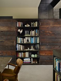 I love this bookshelf in a house by Olson Kundig Architects
