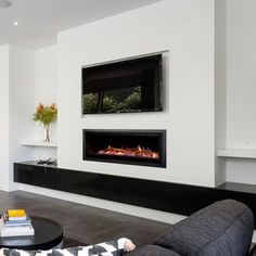 built-in gas fireplace with TV above + built in cabinetry