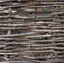 How to make wattle fencing. Add this to the bottom of the deer-proof fencing I pinned.. would be cheaper and beautiful - I've done wattle before - a big thing I learned was to use green wood for the weaving and to leave room in doorways for covering the ends nicely.