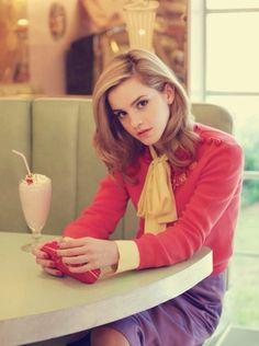 She looks lihe is is in a coffe shopp in the 80's