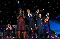 Barack Obama and the first lady, Michelle Obama, celebrate with the vice-president, Joe Biden, and his wife, Jill, after the president's victory speech on election night Photograph: Kevin Lamarque/Reuters