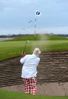 John Daly takes a practice round in Hoylake, England for the Open Championship while wearing Red Tooth Source: ESPN, July 2014 Pga Tour Players, John Daly, Golf Player, Espn, England, Tours, Man Stuff, Sports, Red