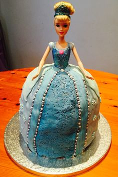 Cinderella cake - Emma's 6th Birthday. Chocolate layers, blue fondant rolled in glitter.