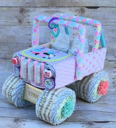 Want a gift NO ONE else will have?? This diaper jeep is PERFECT for your next baby shower! Whether youre looking for a unique baby gift, or an INCREDIBLE diaper centerpiece, this diaper cake is sure to be a crowd pleaser!! These diaper centerpieces are the perfect touches to tie in your baby shower decorations!! ****Each diaper cake is uniquely made. Variations may need to be made based on product availability. Please message me with color schemes and or themes that I need to work with…