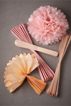 Papered Pom pom. I use these at the girls parties and room decor. Super easy!