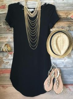 The Fun in the Sun Tunic Dress in Black is comfy, fitted, and oh so fabulous! A great basic that can be dressed up or down!   Sizing: Small: 0-3 Medium: 5-7 Lar