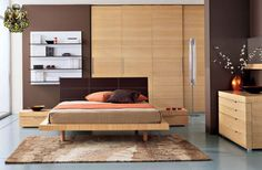 Bedroom set design low profile bed in lite wood color with, matching shelves, racks and cupboards.