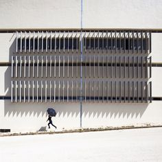 Lebanese photographer Serge Najjar captures abstract architectural images featuring small figures in the urban environment of Beirut.