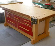 """""""The key to this workbench, """"Malen says, """"is that it sits just 1/4"""" lower than my tablesaw. That way, I can use my bench also as a tablesaw outfeed table. It's an added bonus that the drawers slide out from both sides of the bench, providing easy access to everything I store there."""