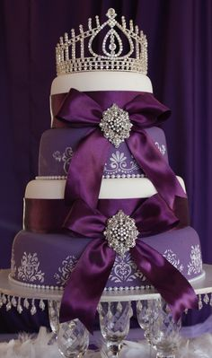 Royal Purple 4 tiered cake :)** If this were blue and white this would be my wedding cake. minus the crown