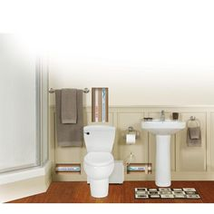 THETFORD Bathroom Anywhere 2 Piece 1.28 GPF Elongated Toilet With Seat And  0.80 HP Macerating Pump In White