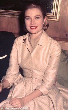 Grace on the day her engagement was announced and she is wearing a gold flower pin.