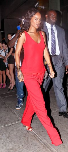 Rihanna rocks a red ensemble straight off of that day's Edun S/S 15 runway. // #Celebrity