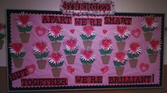 "This is our February Leader in Me bulletin board.  We ""synergized"" by having the students trace/cut out each others hands for the petals of the flowers. Then the class brainstormed different ways to effectively syngergize and we wrote the examples in the middle of the flowers."