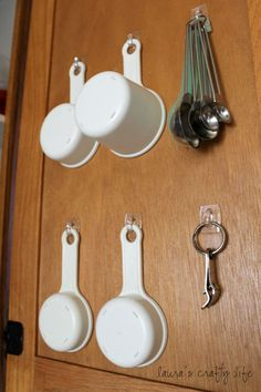 Hang measuring cups & spoons inside cabinet door with Command hooks